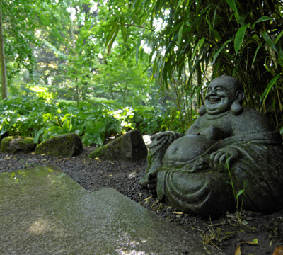 Buddha sculpture made out of stone sitting at the Japanese Garden