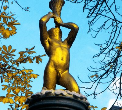 Closeup-view of the golden putto at top of the St. Martin's Fountain