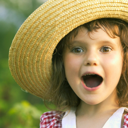 Smiling girl with sun hat