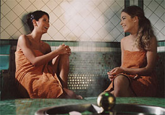 Two women sitting side by side at the monte mare sauna