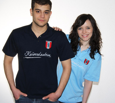 Man and woman wearing a dark and light blue polo shirt with the writing 'Kaiserslautern' as well as the coat of arms
